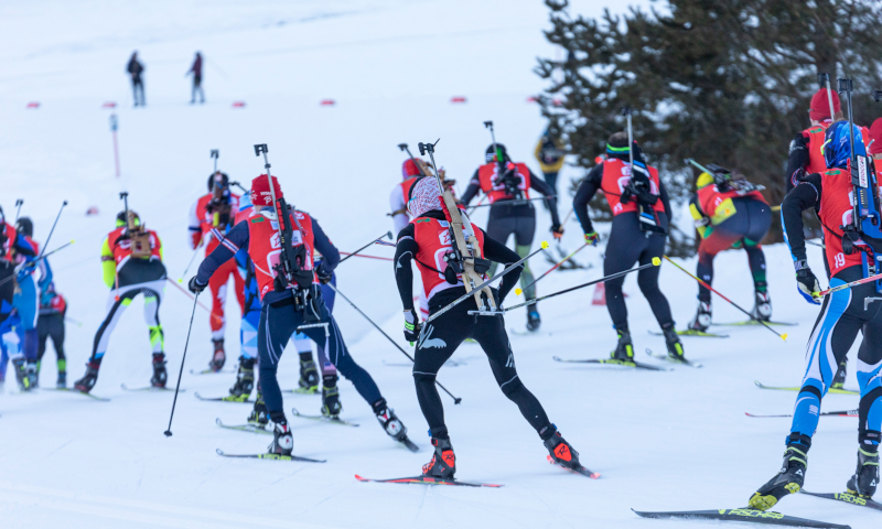 Several biathletes standing during shooting