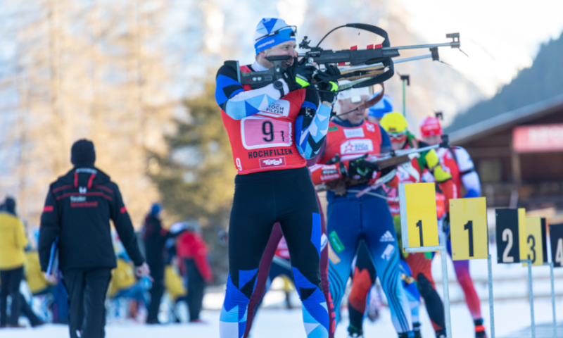 Several biathletes lying during shooting