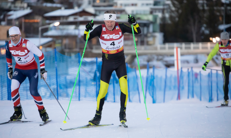 Several cross-country skiers during a climb