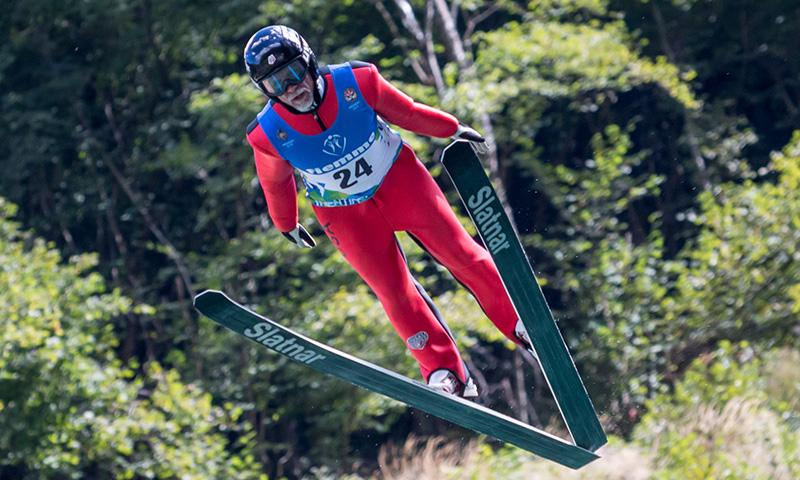 Ski jumper during the jump from the front